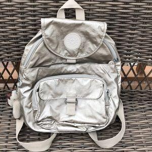 Kipling metallic backpack lots of zipped pockets